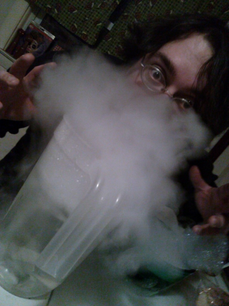 A friend photographed vapor bubbling up from a jug in front of my face, hiding all but my eyes, forehead, and hands gesturing like a mad scientist.