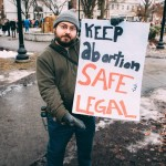 """Bryant Naro photographed me holding a sign reading, """"Keepo abortion safe & legal"""" at the Keene Women's March."""